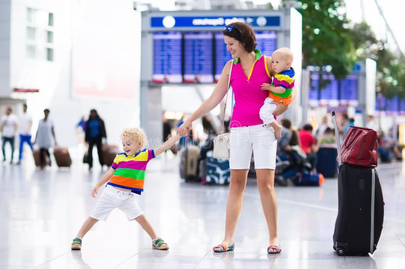 Family at airport before flight stock images