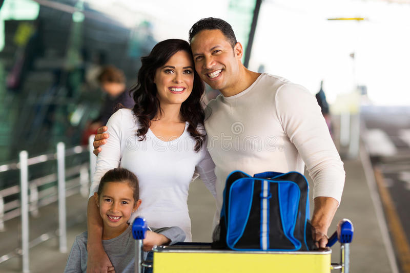 Family at airport stock images
