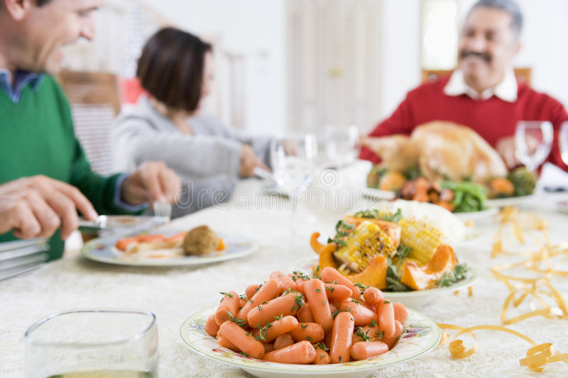 Family All Together At Christmas Dinner stock images