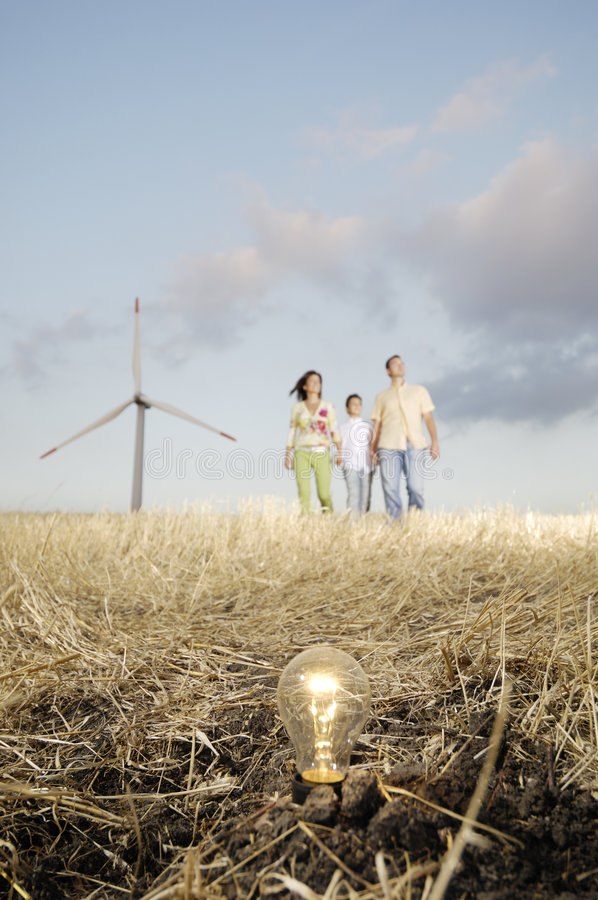 Free Family And Wind Turbines, Light Bulb In The Ground Stock Photography - 8688672