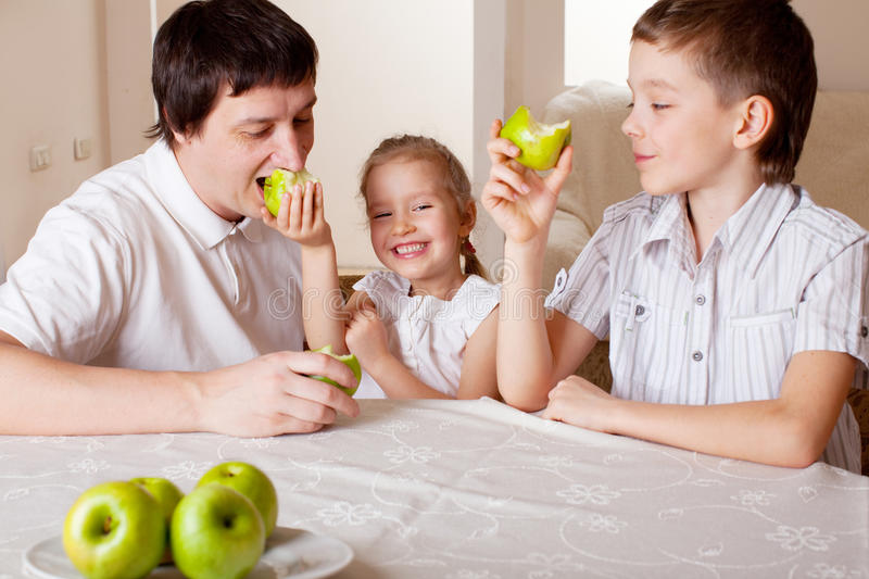 Family with apples stock photos