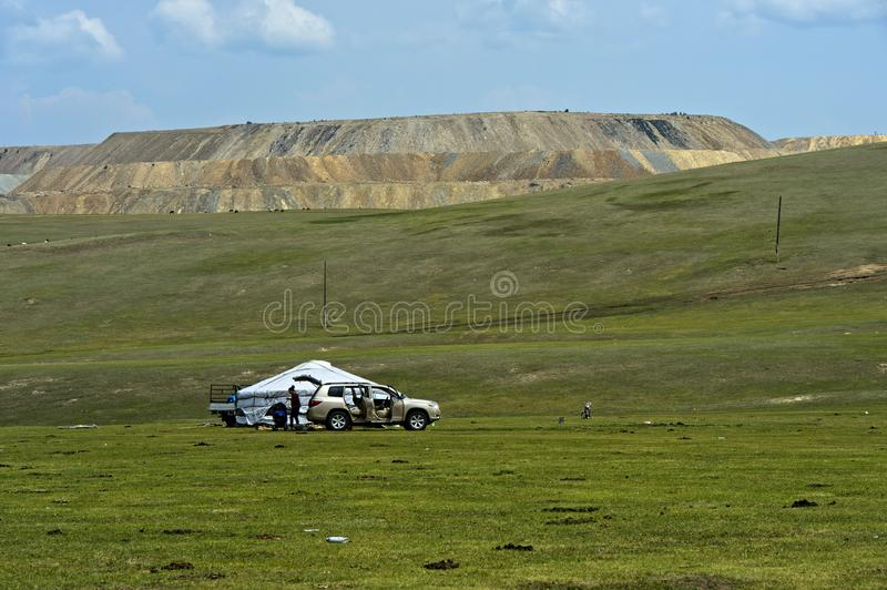 Family arriving by car at its yurt stock image