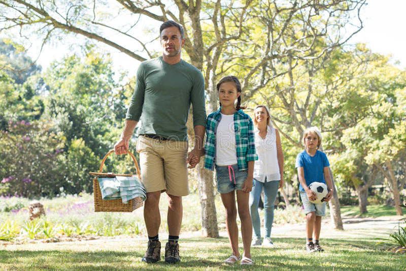 Family arriving in the park for picnic royalty free stock images