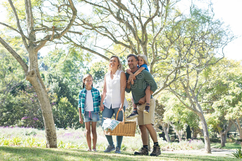 Family arriving in the park for picnic royalty free stock photos