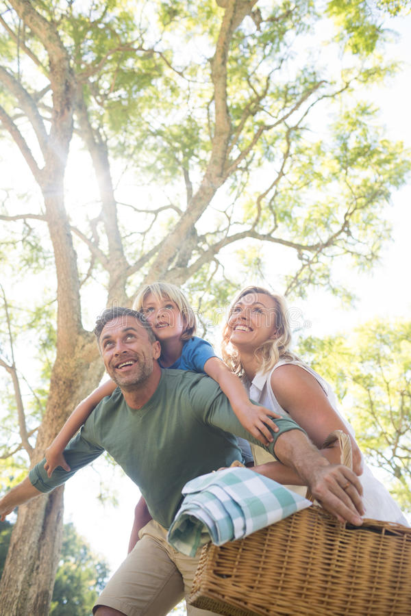 Family arriving in the park for picnic on a sunny day stock photography