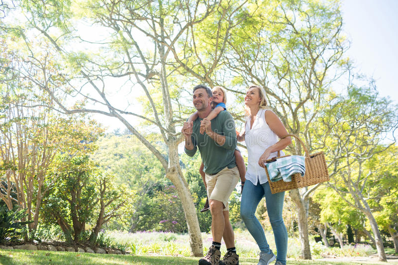 Family arriving in the park for picnic on a sunny day stock photo