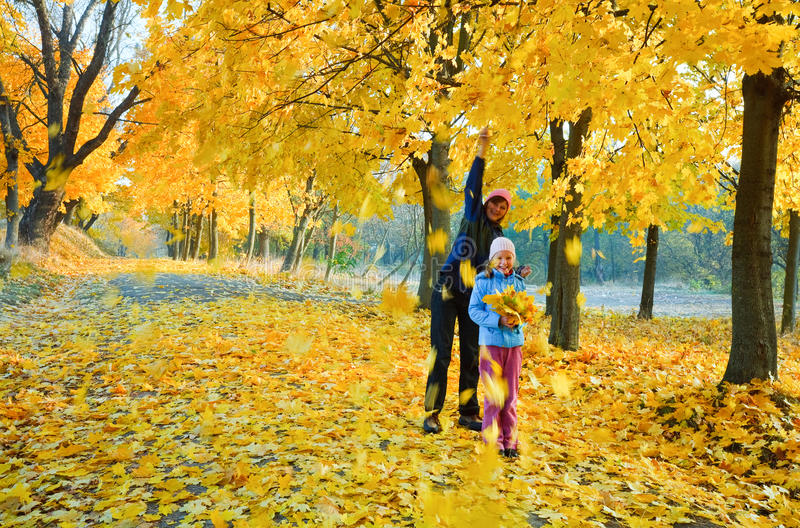 Download Family In Autumn Maple Park Stock Photo - Image: 23074596
