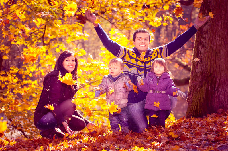 Family in the autumn park stock images