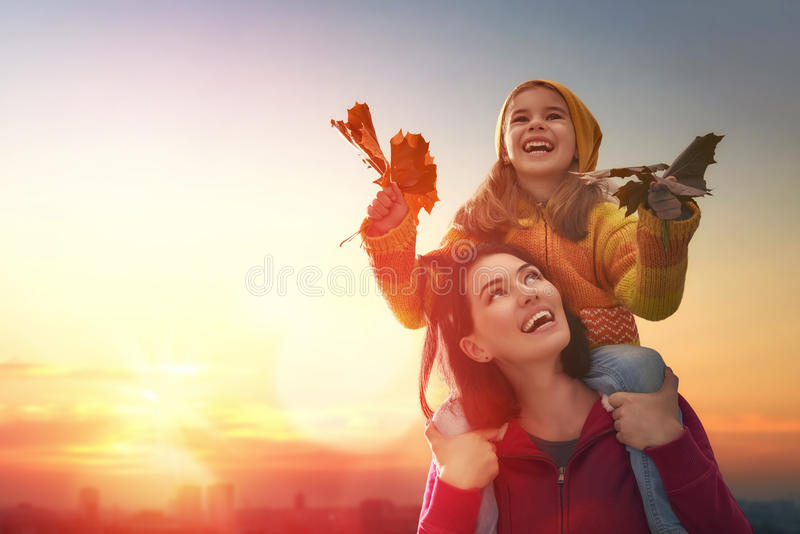 Family on autumn walk stock images