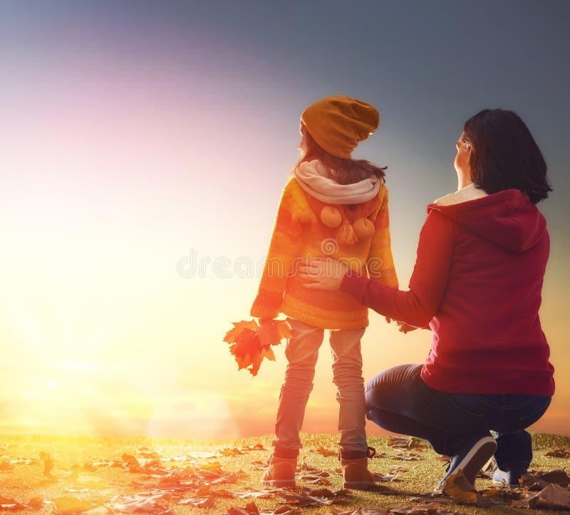 Family on autumn walk royalty free stock photography