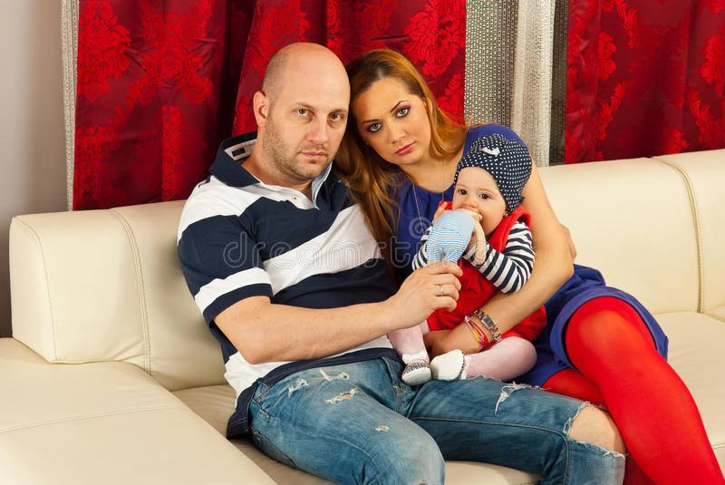Family with baby on couch stock photos