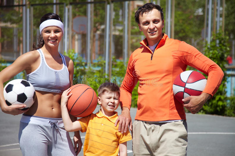 Family with balls royalty free stock photos