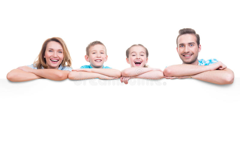 Family with a banner. Young family with a banner - isolated on a white background