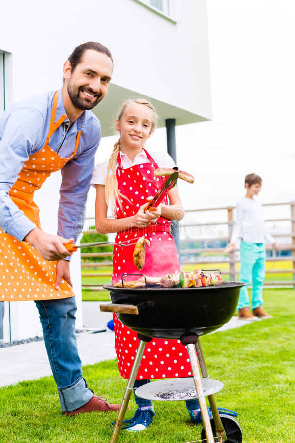 Family barbecue in garden home. Family barbecue together in garden home royalty free stock photos