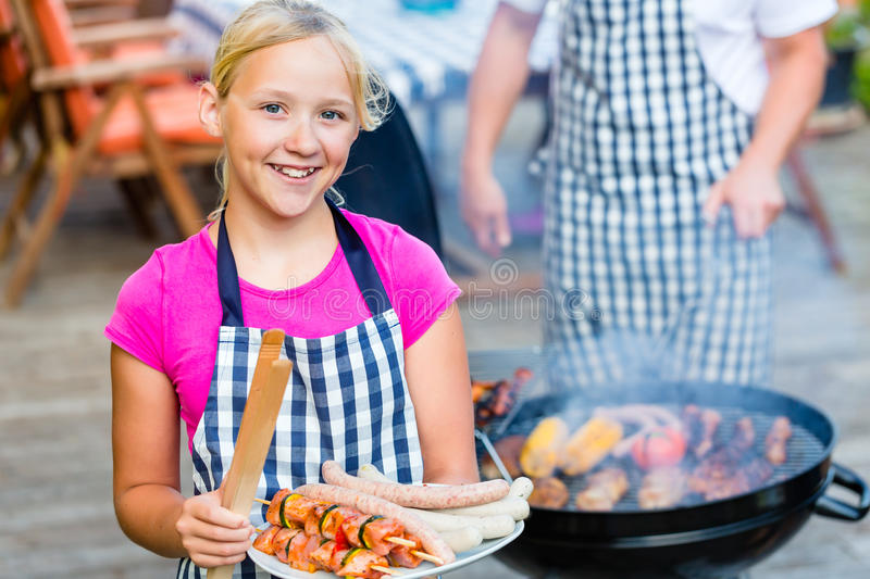 Family barbecue together on terrace. Family having barbecue food on grill at family garden BBQ stock images