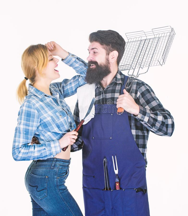 Family barbeque. Family weekend. Picnic barbecue. food cooking recipe. Tools for roasting meat. Couple in love hold. Kitchen utensils. Man bearded hipster and royalty free stock photography