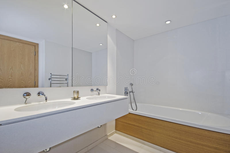 Family bathroom. Luxury family bathroom with double hand wash basin and floor to ceiling stone tiles stock photography