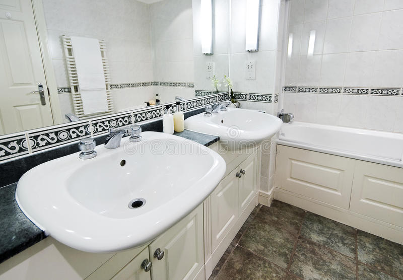 Family bathroom. With two sinks and large mirror royalty free stock images
