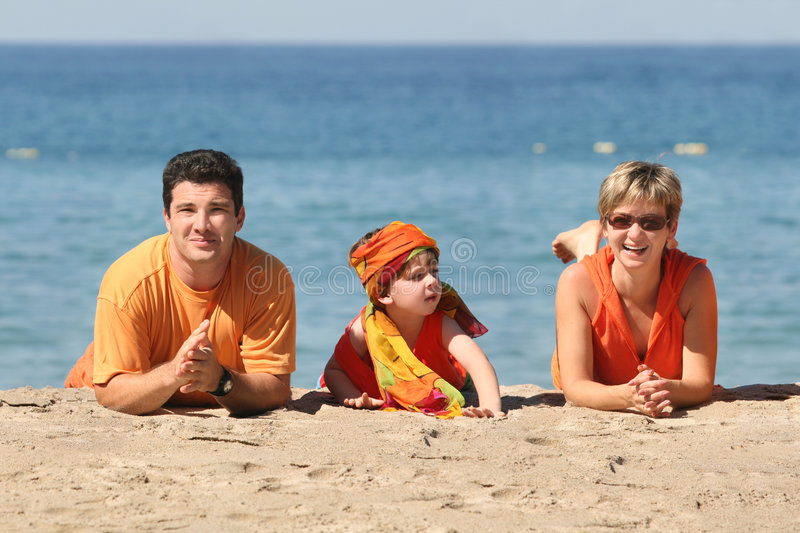 Family on the beach stock images