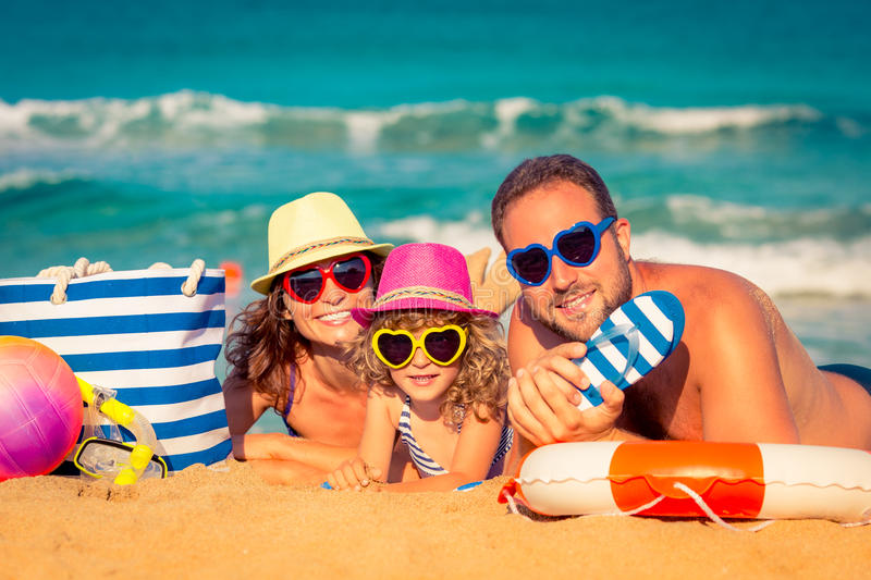 Family at the beach. Happy family playing at the beach. Summer vacation concept
