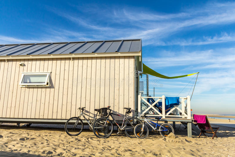 Family beach vacation. Kijkduin beach, the Netherlands - August 25, 2016: holiday beach huts royalty free stock photo
