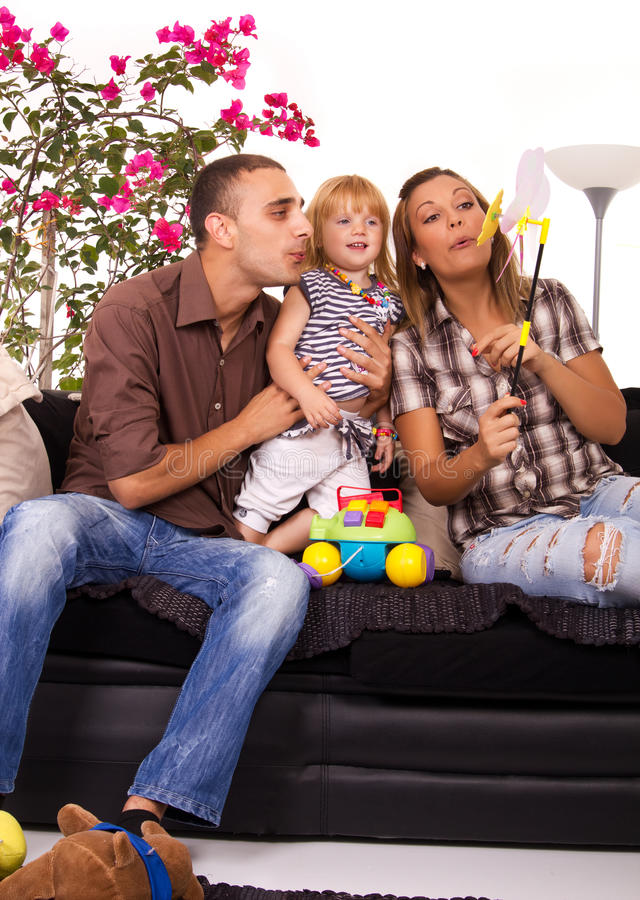 Family in bed playing and smiling royalty free stock photo