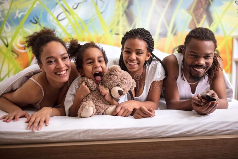 Family in bed together having fun royalty free stock photography