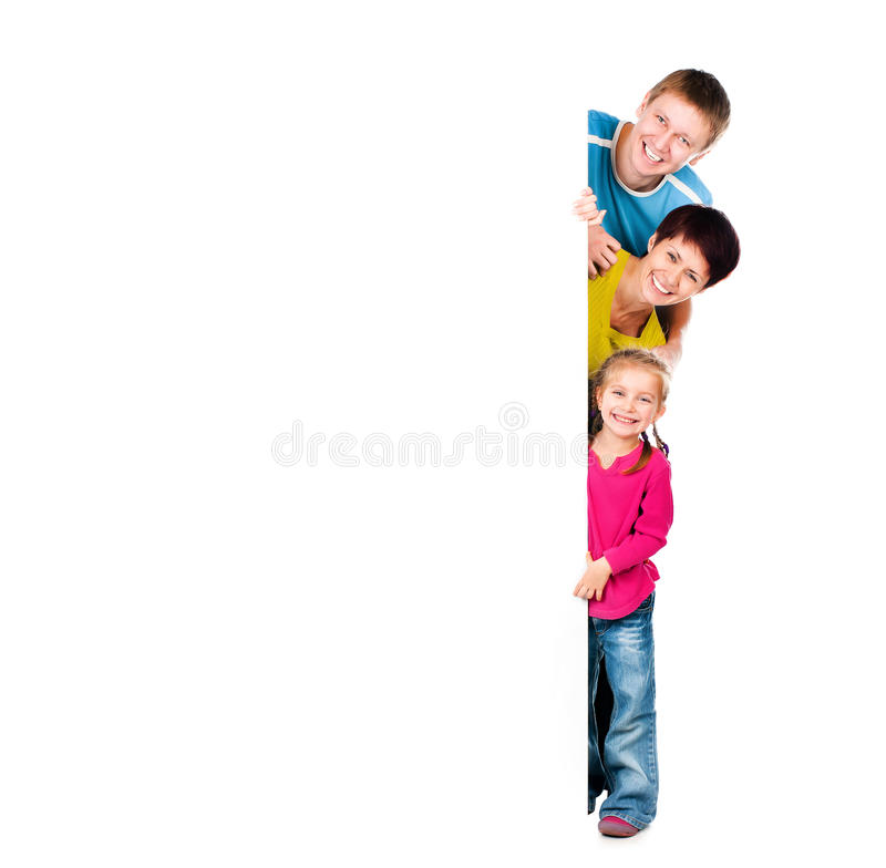 Family behind a blank. Beautiful fun family behind a white blank royalty free stock photos