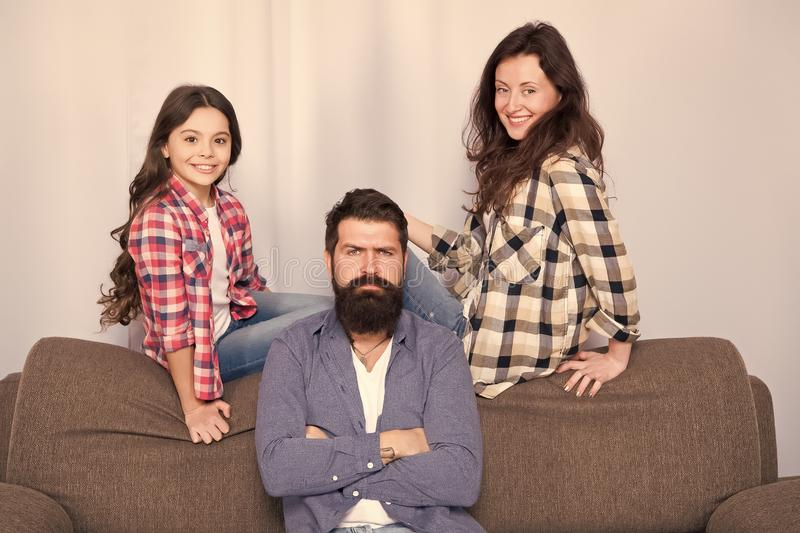 Family is Best. Bearded man and woman with daughter. Little girl love her parents. Childrens day. Father, mother and stock photo