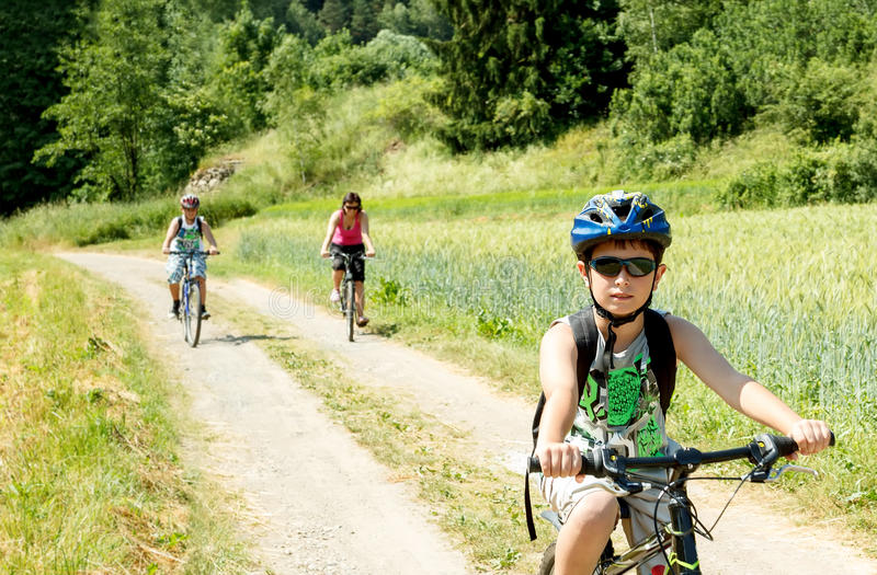 Family on bicycle trip stock images