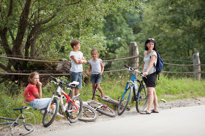 Family with bicycles royalty free stock photo