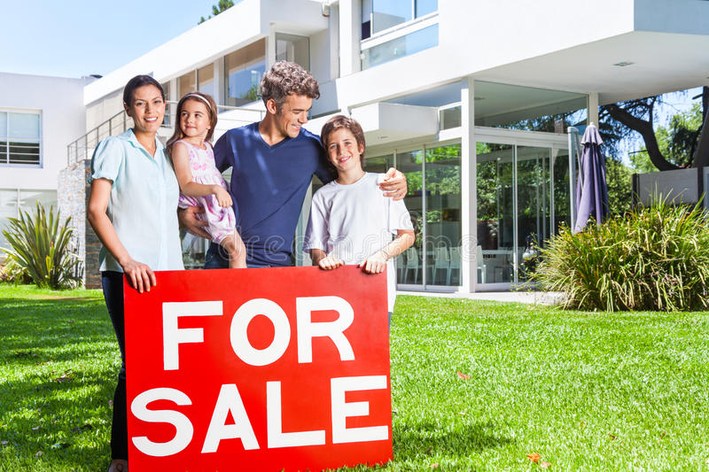 Family in big house stock photography