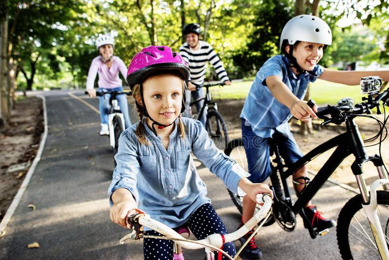 Family on a bike ride in the park stock image