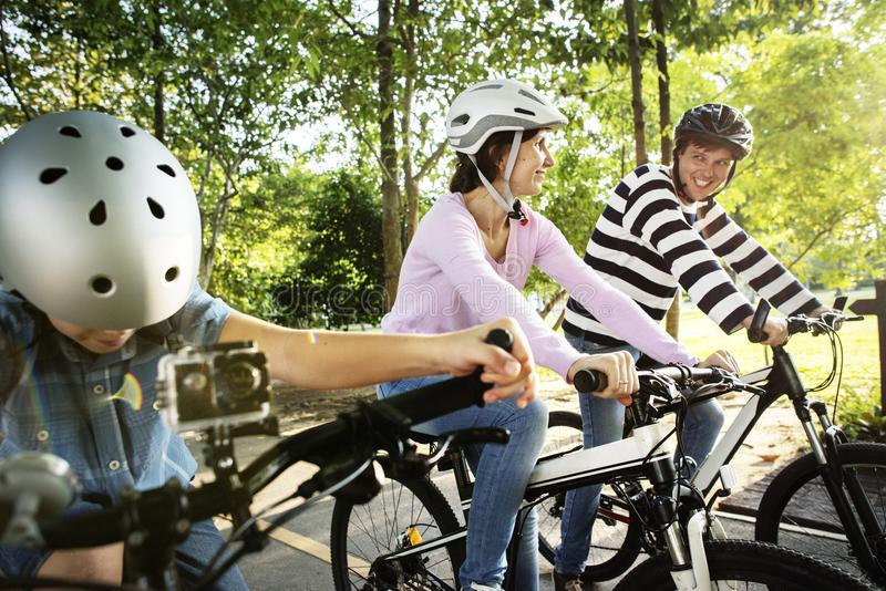 Family on a bike ride in the park stock photos