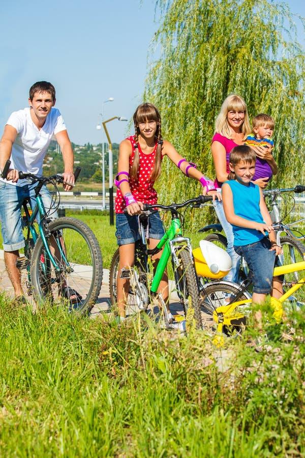 Family on bikes stock image