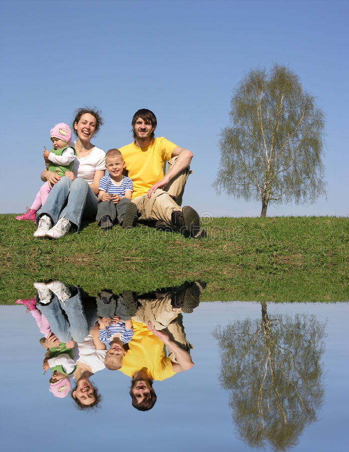 Family with birch and water royalty free stock photos
