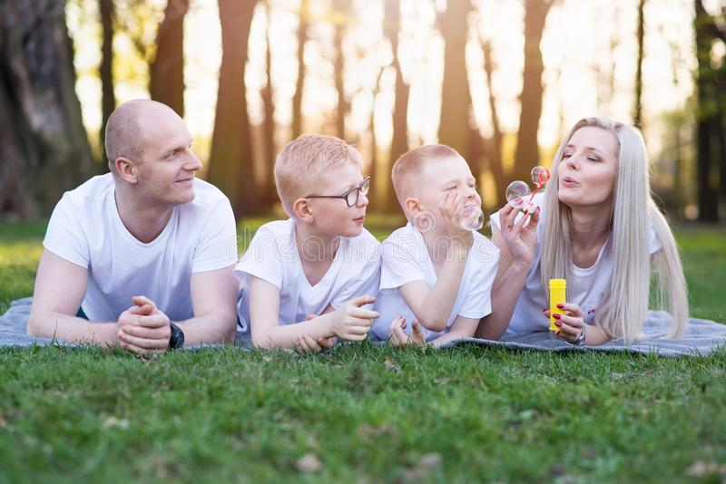 Family blowing soap bubbles royalty free stock image