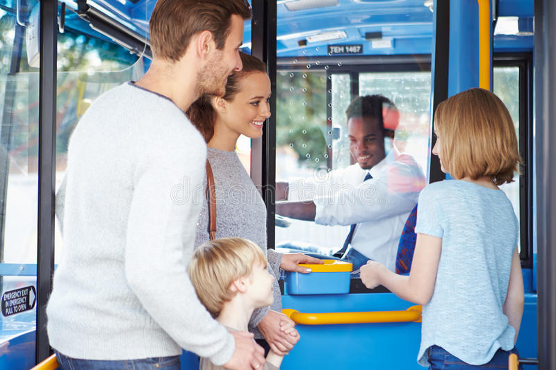 Family Boarding Bus And Buying Ticket stock photography
