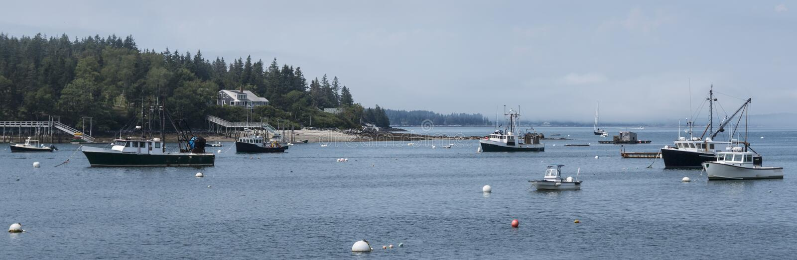 Harbor in Maine with commercial fishing boats moored royalty free stock photography