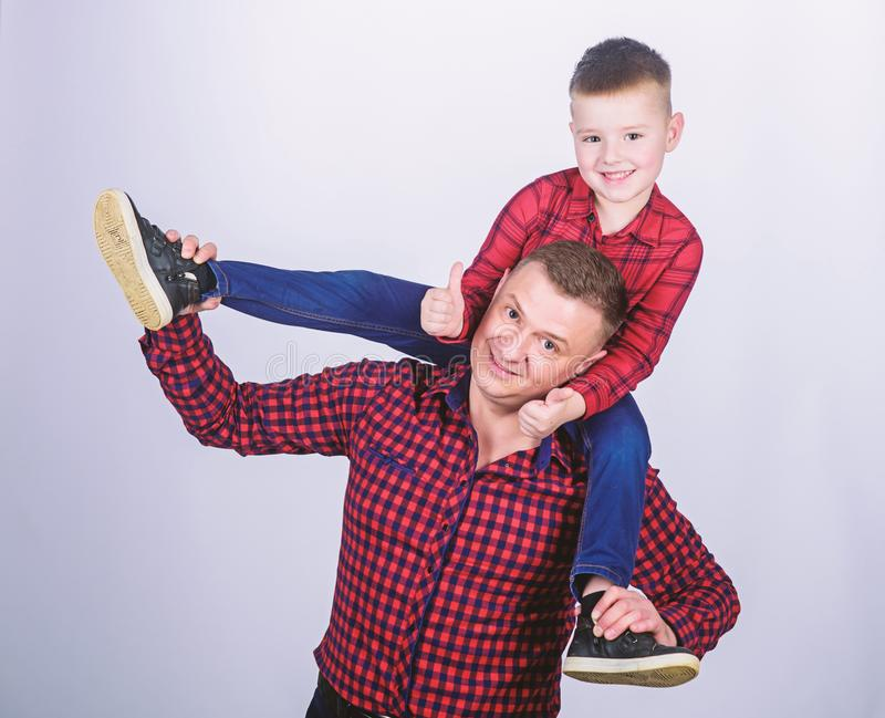 Family bonding. childhood. parenting. happy family. father and son in red checkered shirt. fathers day. little boy with royalty free stock photo