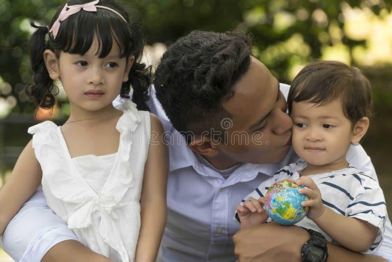 Malay family at recreational park having fun royalty free stock photo