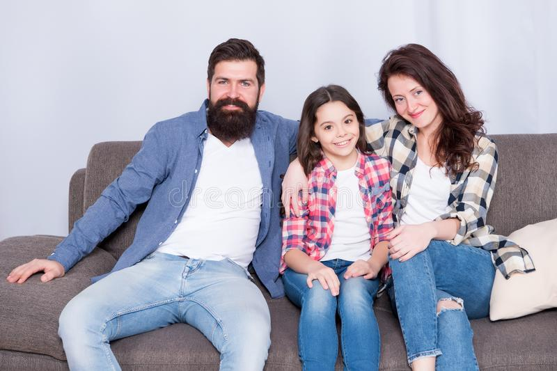 Family bonds. happy family relax at home. family weekend. mother and father love daughter. just relax. little girl with. Parents. relative bonds. bearded men stock photo