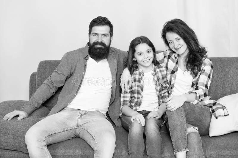 Family bonds. happy family relax at home. family weekend. mother and father love daughter. just relax. little girl with. Parents. relative bonds. bearded men royalty free stock images