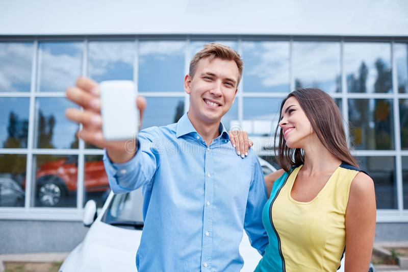 The family bought a new car in the showroom. The concept of buying a new car. stock photo