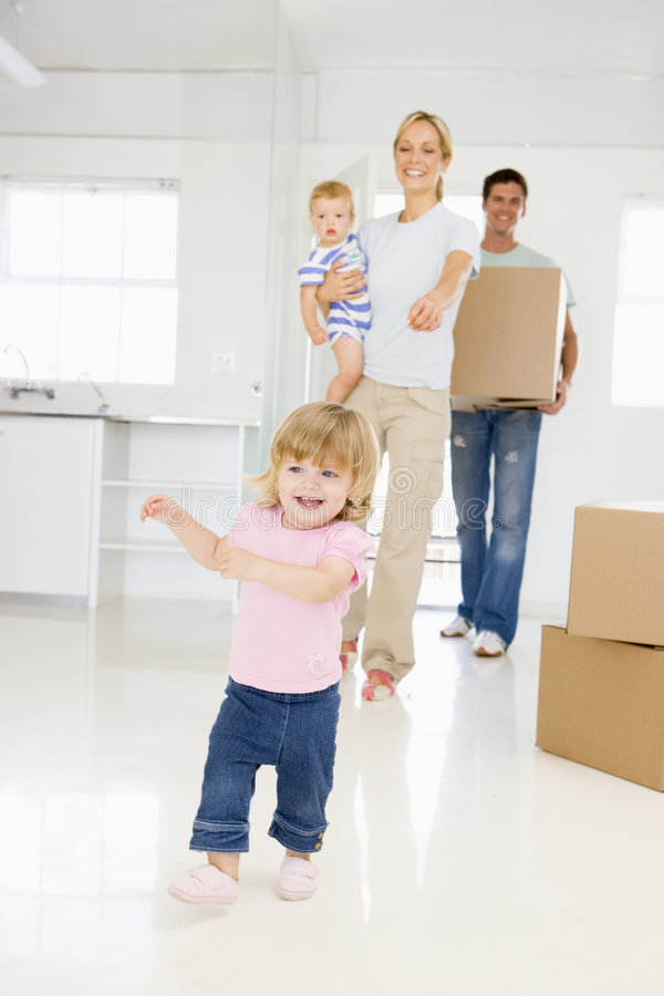 Download Family With Box Moving Into New Home Smiling Stock Image - Image: 5942617