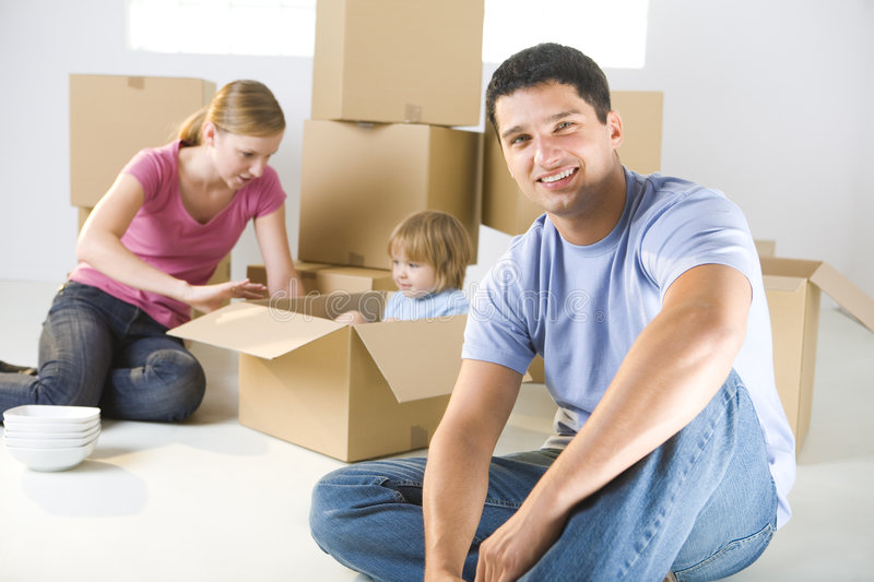 Family between boxes royalty free stock image
