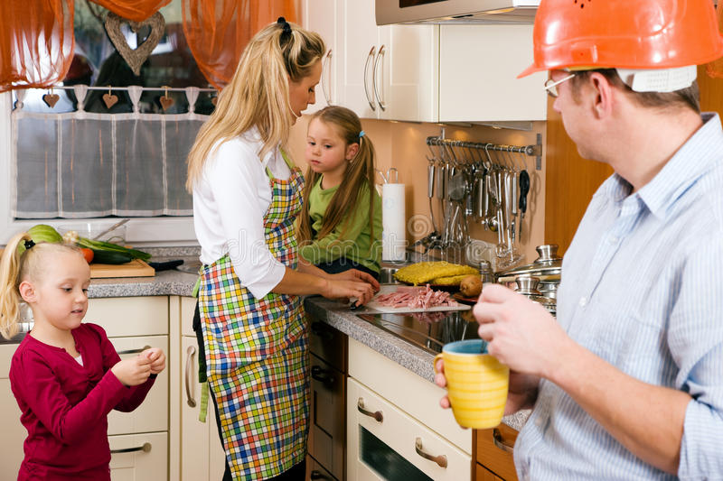 Family and breakfast. Family doing their breakfast routine in the morning, dad is ready to start to work royalty free stock images