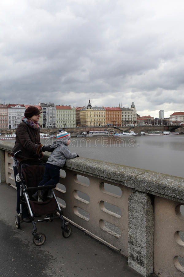 Family on a bridge. In Prague, Czech republic royalty free stock images