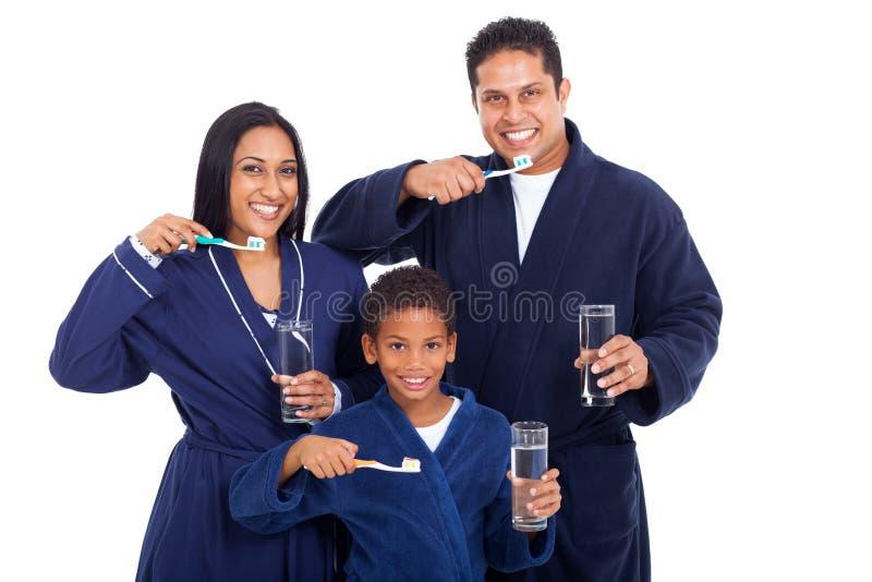 Family brushing teeth stock images