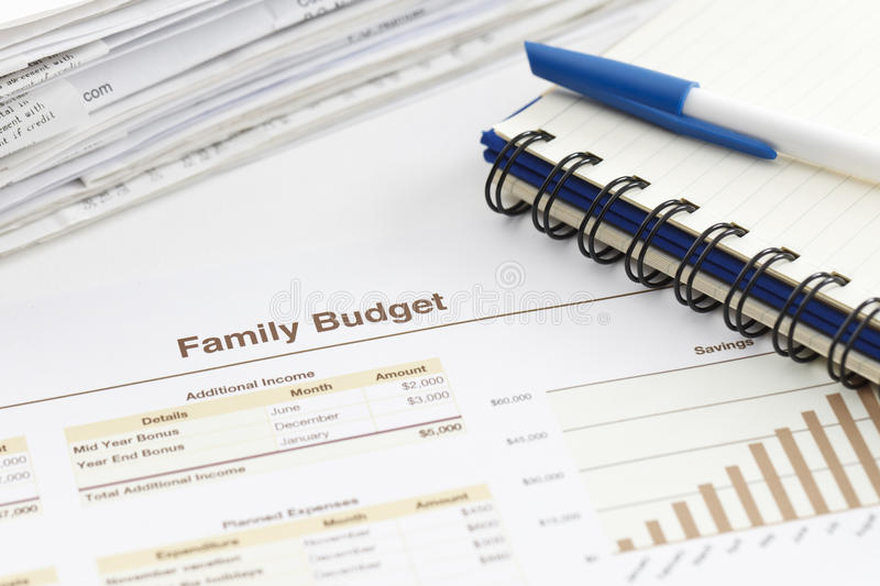 Family Budget. Spreadsheet printout, pile of receipts and a spiral notebook royalty free stock images